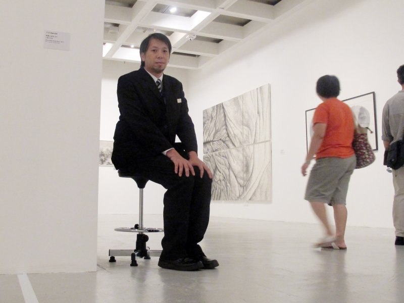 Luke-CHING-Chin-Wai-A-Security-Guard-at-Hong-Kong-Contemporary-Arts-Biennial-Performance-documentation-2013